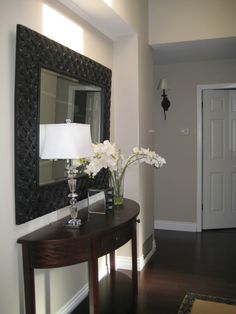 This is a pretty vignette for a front entrance. Paint color: Benjamin Moore's revere pewter. Have to love Revere pewter.