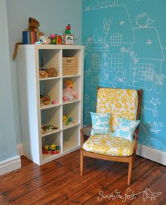 A restored vintage Parker Knoll chair with yellow and white upholstery in our baby daughter's turquoise nursery by Simply The Nest