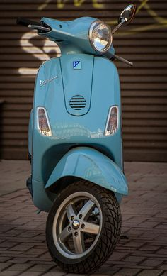 Vespa...my hubby got me a sweet Vespa today...I am so in love with it...lol...and my hubby!!!