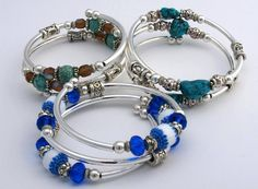 """Caméléon would like to give a big welcome to our newest line: The Embraceling Bracelet by CrazyartGrrl! As a resident of the greater Buffalo, NY region, Kristine is extremely proud of the fact that every piece is hand made in WNY (and so are we)! Their mission: """"to provide beautiful, unique jewelry that not only fits every body, but fits every budget!"""" Be sure to stop in next time you're near a Caméléon store and check out the newest addition to our stores!"""