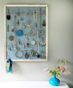 The classic frame-as-jewelry-holder-and-piece-of-art DIY idea :)