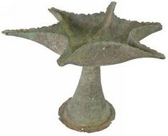 "Bronze six spout oil lamp with incised linear and floral motifs. Size: 5 ¾"" x 7 ¾"" Date: 900 AD"