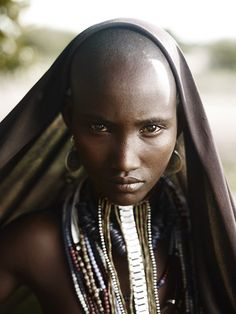 What does she see through the lens of her culture? Portrait of Rufo, Arbore Tribe, Omo Valley, Ethiopia from Abyssinia: The Cradle of Mankind copyright Joey L./photokunst