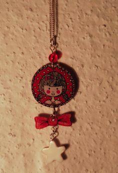 pendentif fillette à pois rouge noeud étoile plastique dingue