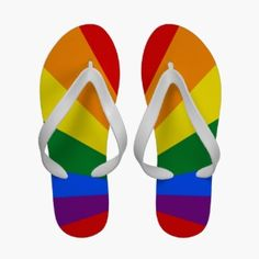 LGBT Gay Pride Color Rainbow Flip Flops. These sandals feature a colorful design based on the gay pride rainbow LGBT flag where the rainbow colors red, orange, yellow, green, blue and purple radiate outwards from a centerpoint against a background of red on each flip flop.