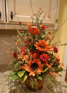 Fall Flower Arrangement I Use 3 Sizes Of Pumpkins For Tabletop This One Is Very Simple And Pretty Boot Centerpieces Pinterest