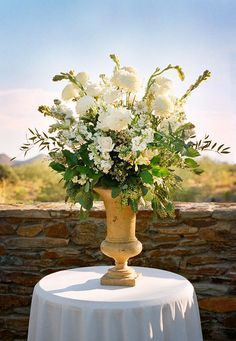 Natural, White Wedding Flowers - put in a tall vase with river rocks and that would be perfect for the entry way to the church. Or for our two ceremony urns!