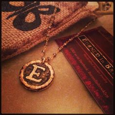 BurnedinBrooklyn handcrafted wooden pendant on 14kt gold and Marcasite chain. https://www.etsy.com/shop/BurnedinBrooklyn