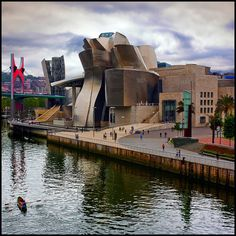 El Museo de Arte Contemporáneo Guggenheim de Bilbao- The museum revitalized Bilbao and it became the  major tourist attraction of the Basque region of Spain.
