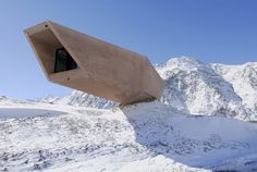 """The concrete structure on the North Tyrolean side juts out like an erratic boulder into the South Tyrolean side, underlining the cross-border nature of the Timmelsjoch Experience. The """"Ice Cave"""" inside the museum pays tribute to the pioneers of the High Alpine Road and their remarkable accomplishment"""