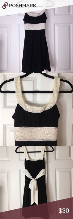 Formal Dress Black and White Formal Dress. NEW condition, worn only once. Ties in the back, great quality. Perfect for any special occasion ✨ Dresses