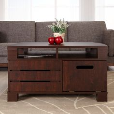 Allow country elegance to blend into your urban decor with this wonderfully unique and stylish piece! The coffee table features handy, hidden and pre-sectioned shelves, along with multiple covert drop-down doors that easily store bulky pieces.  Overall dimensions: 18.3 inches high x 31.5 inches wide x 31.5 inches deep