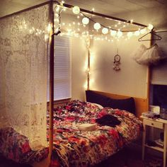 Want a cheap canopy bed? Find a simple brown or black frame and some PVC pipe.