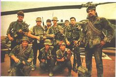 A group of Navy SEALS and a couple of South Vietnamese soldiers during the Vietnam War. Note the mix of the U.S's new toys at the time; the M16, the M60 and the Stoner 63. More than likely someone has an M79 also, since one guy has the grenade vest.