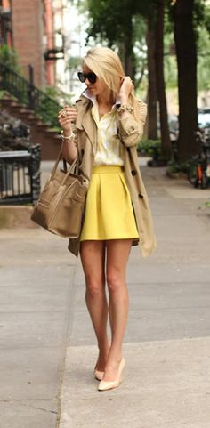 long trench and yellow pleated skirt.