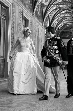 Grace Kelly and Prince Rainier III of Monaco.  1956.  The beautiful bride wore a gown presented to her by the MGM film studios, made by Oscar-winning designer Helen Rose, while her groom designed a military-style uniform especially for the occasion