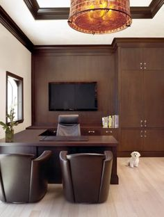 Mature Office: Wood and leather in chocolate hues contrast with the cream walls of this dignified office.