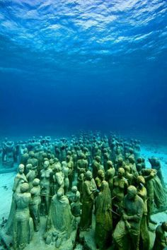 underwater sculpture museum off the coast of Isla de Mujeres and Cancun, Mexico. We snorkeled off of the Isla de Mujeres the last time we were in Cancun but we missed this. Definitely need to see this the next time we are in Cancun. Places To Travel, Places To See, Places Around The World, Around The Worlds, Underwater Sculpture, Disneyland Secrets, Thinking Day, Mexico Travel, Dream Vacations
