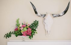 A Lovely Arrangement. I want one of these old skulls for the dining room. #DIY #homedecor #style