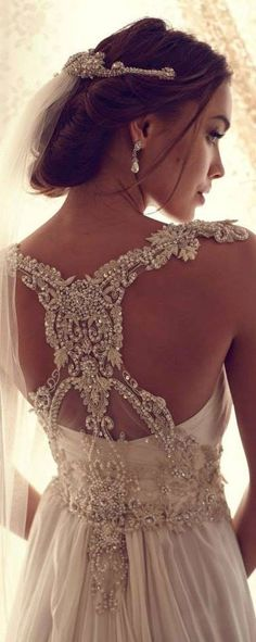 Wedding Dresses by Anna Campbell 2013. Intricate back detail beading.