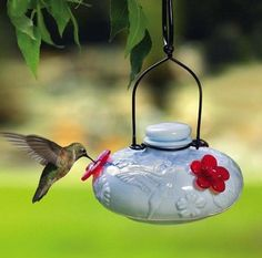 Recycled Milk Glass Hummingbird Feeder The Bloom Calliope hummingbird feeder with nostalgic appeal features a raised floral pattern in a clean, basin style feeder... no drip, no mess. Patented ruby re
