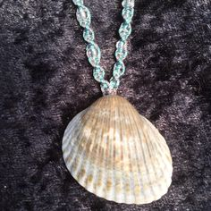 Handcrafted beaded macrame necklace featuring a Seashell with an adjustable fastener. One of a kind.