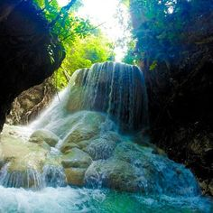 takes a photo of Aguinid Falls in Samboan,Cebu