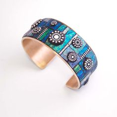 Mosaic Brass Cuff Bracelet with iridescent polymer clay inlay and Sterling Silver. $210.00, via Etsy.