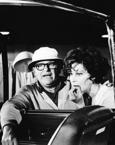 Director Mark Robson and Ava Gardner on the set of Earthquake (1974)