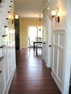Front hallway after the kitchen entry is widened ..Love the trim on the walls