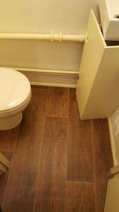 Dark wood effect vinyl in a bathroom Portland Street, Dark Wood, Tile Floor, Flooring, Bathroom, Washroom, Dark Hardwood, Full Bath, Tile Flooring