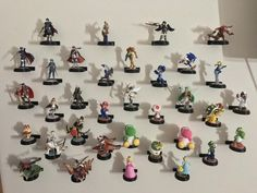 Photo credit r/amiibo u/ashtekka. 3D printed stands and attached to the wall with command straps. 3D file here https://www.thingiverse.com/thing:886653