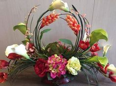 "Designed by Arcadia Floral & Home Decor. This is one of our original styles called the ""Welcome Arrangement"". It's perfect in a foyer, dining room, kitchen ledge, or mantel!"