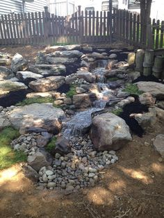 This is a recently completed project in Lancaster County, PA consisting of natural stone steps with a limestone boulder retaining wall and a 15' pondless waterf…