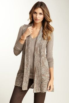 Sweater vest in shades of brown. Great for Fall and Winter with a long sleeved top and leggings.