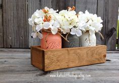 Rustic Planter Box with 3 Painted Mason Jars. Mason Jars. Rustic Home Decor. Vintage. Grey. Cream. Peach. Table Centerpiece. by Kateslittleshop on Etsy https://www.etsy.com/listing/186119681/rustic-planter-box-with-3-painted-mason