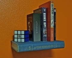 Floating bookshelves made from old books! Instructions and other inspirational photos are found on instructables.com.
