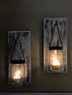 Pair of Mason jar Candle sconces with brackets included for hanging.  Dark stain then painted white with the distressed look.  Please message seller