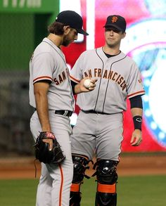 Caption:MIAMI, FL - JULY 18: Catcher Buster Posey #28 (R) of the San Francisco Giants chats with Pitcher Madison Bumgarner #40 prior to playing against the Miami Marlins at Marlins Park on July 18, 2014 in Miami, Florida
