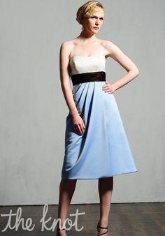 Dress features gathered waist, draped skirt, and matching wrap.
