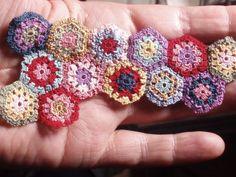 Tiny thread crochet granny hexagons for dollhouse bedspread. From Hanna & Leijona's blog on Miniatures and Life