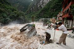 A worker repairs an access road to Machu Picchu, which was damaged by the floodwaters of the Vilcanota river, after torrential rains in Cuzco, Peru