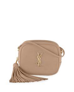 """Saint Laurent calfskin leather crossbody bag. Golden hardware. Adjustable crossbody/shoulder strap; 23.6"""" drop. Zip-top closure. Hanging tassel detail on side. YSL logo plate on body. Interior pocket."""