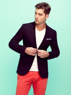 Shop this look for $77:  http://lookastic.com/men/looks/red-chinos-and-white-v-neck-t-shirt-and-navy-blazer-and-white-and-navy-pocket-square/711  — Red Chinos  — White V-neck T-shirt  — Navy Blazer  — White and Navy Houndstooth Pocket Square