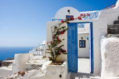Beautiful Santorini - wide open blue door and pretty bougainvillea