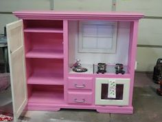 Kitchen made from an old entertainment center - - I don't have a little girl but this is stinkin adorable!!