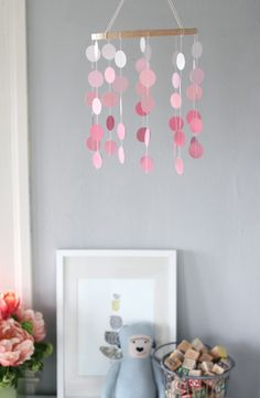 Another cute paint chip mobile- I think it would be even cuter if you wrapped the wooden embroidery hoop in yarn.