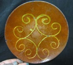 Early redware plate measures 9'' dia. Probably made in Norwalk Connecticut. Two tight lines and some minor chips. Shows good hearth use. Some crazing. Very nice yellow slip decoration with only minor loses. Offered 4/28/14 on ebay.