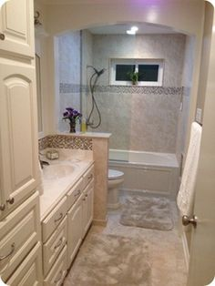 example of taking down the wall: after. Just like this, with half-height wall (at shower for us) and ledge extending behind the vanity.