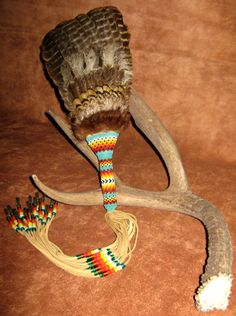 Beaded Feather Dance Fan/ Smudge Fan, Peyote Stitch beadwork with Turkey, Pheasant and Peacock feathers, deerskin, mink, and glass beads. $250.00, via Etsy.